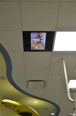 TV in ceiling in Treatment Room